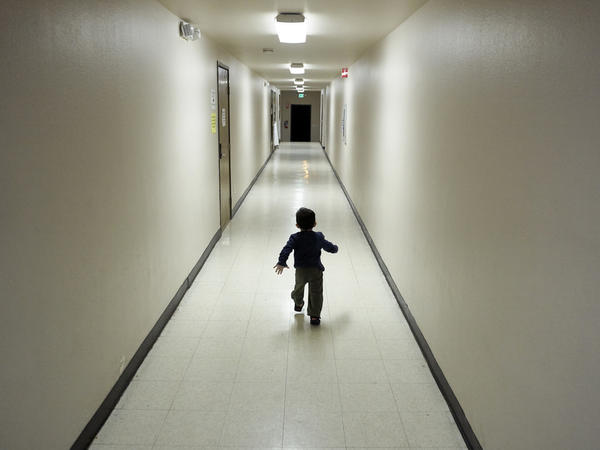 An asylum-seeking boy Central American boy runs after arriving from an immigration detention center to a shelter in San Diego in December 2018.