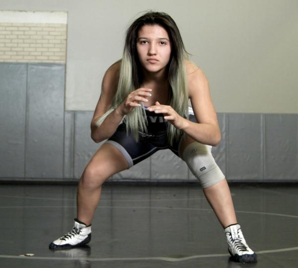 Jaslynn Gallegos settles into her wrestling stance.