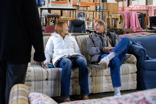Mary and George Hayes test the comfort level of the couch they chose at the Home Sweet Home furniture bank.