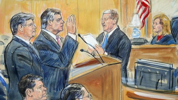 This courtroom sketch depicts former Donald Trump campaign chairman Paul Manafort (center) before U.S. District Judge Amy Berman Jackson in September 2018. She is scheduled to sentence Manafort on Wednesday.