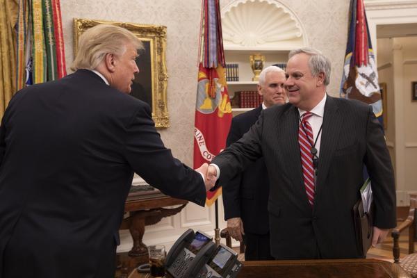 Acting Interior Secretary David Bernhardt shakes hands with President Donald Trump.