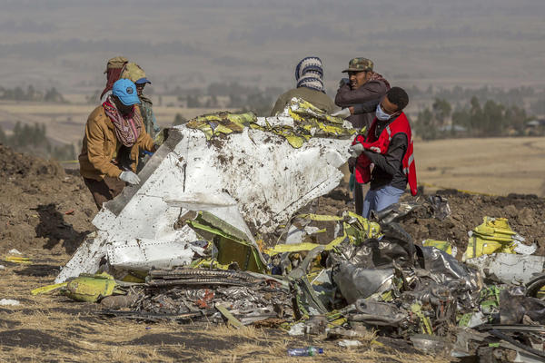 Responders at the scene of an Ethiopian Airlines flight crash. Countries around the world have grounded their Boeing 737 Max jets and there is growing political pressure on the Federal Aviation Administration to do the same.
