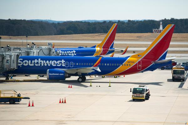 A Boeing 737 Max 8 flown by Southwest Airlines sits at the gate at Baltimore Washington International Airport on Wednesday. Per the FAA order, Southwest said it has removed its 34 Max 8s from service.