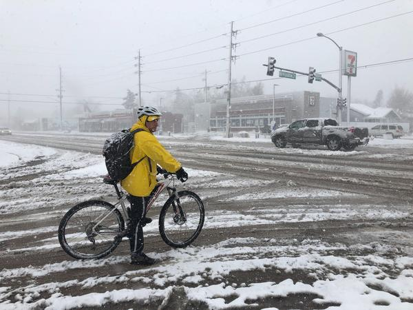 Tracy Stahl rides his bicycle on Franklin Street in south Denver. Stahl said he attempted to make his daily commute downtown before he encountered streets that were closed during the blizzard conditions.