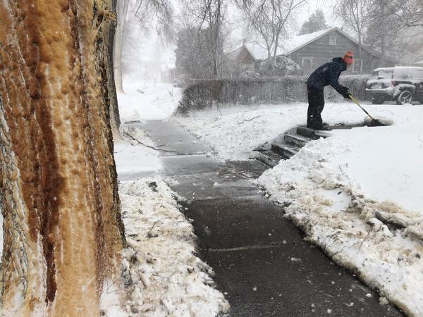 Eric Rice clears a path to his front door in south Denver.