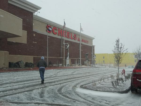 Shoppers brave the snow Wednesday morning in Loveland.