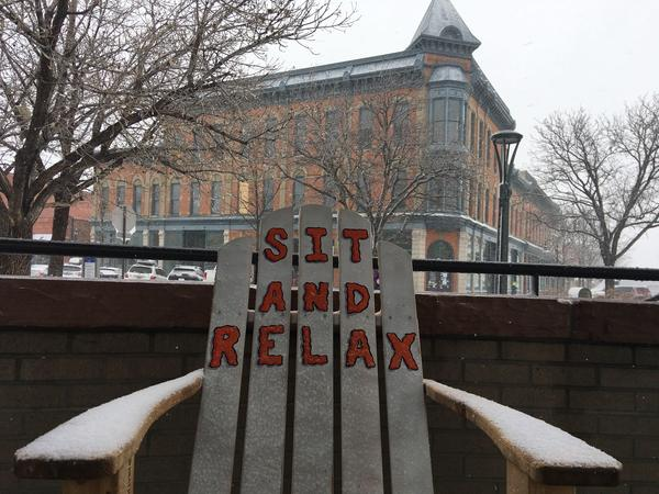 A chair offers advice for the storm in Old Town Fort Collins.