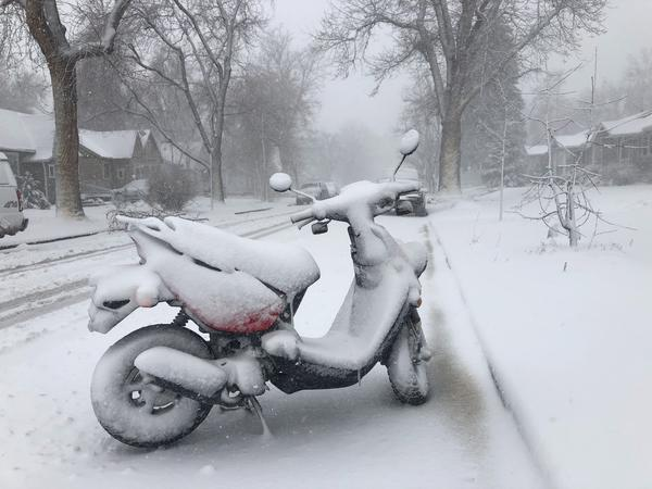 A snow-covered scooter in Denver.
