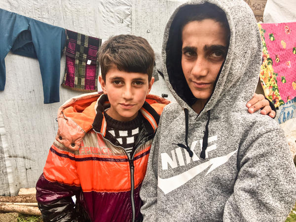 Mazen (right), 13, and his brother Mezban in a camp for displaced Yazidis in the Kurdistan region of Iraq. Mazen was freed recently, five years after being kidnapped by ISIS. He was found in Baghouz, the last ISIS stronghold in Syria. His brother was also kidnapped and, 2-1/2 years ago, was rescued with their mother. The boys' father is still missing.