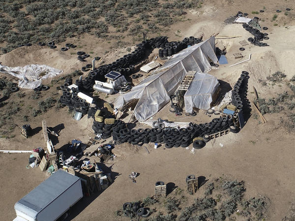 A ramshackle compound in the desert area of Amalia, N.M. Five former residents were indicted on terrorism and gun charges.