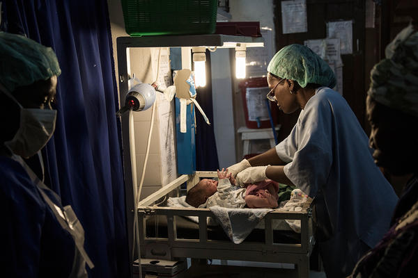 Doctors treat a baby whose mother underwent a cesarean section in Sierra Leone. Doctors Without Borders has worked to help reduce the country's high maternal mortality rate.