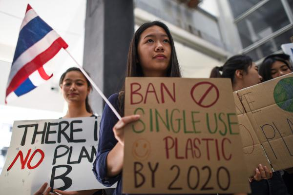 In Bangkok, students display placards during a demonstration to protest against climate change.