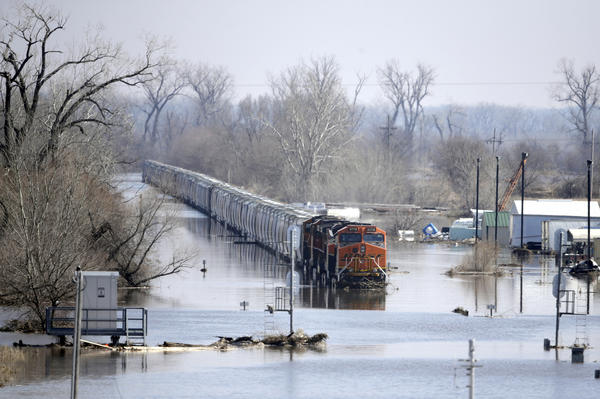 A BNSF train sits in floodwaters from the Platte River in Plattsmouth, Neb., on Sunday. Hundreds of people remained out of their homes in Nebraska as rivers began to recede.