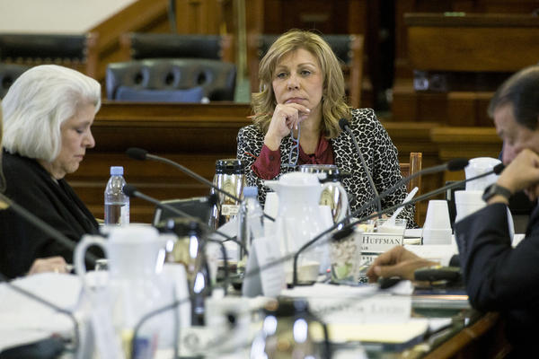 Republican Sen. Joan Huffman of Houston listens during a State Affairs Committee hearing during the last legislative session in 2017.
