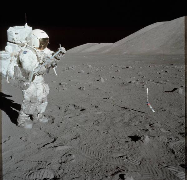 Astronaut Harrison H. Schmitt collects rock samples at Station 1 during the first Apollo 17 extravehicular activity at the Taurus-Littrow landing site, December 1, 1972, using a lunar rake tool.