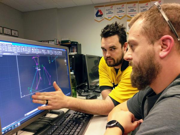 WSU Tech professor Jeremy King assists a student in his geometry course.