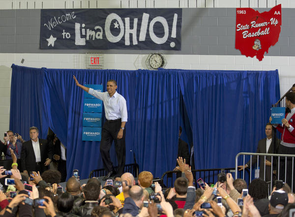 President Barack Obama waves to the supporters as he arrives to speak at a campaign event at Lima Senior High School, Friday, Nov. 2, 2012, in Lima, Ohio.