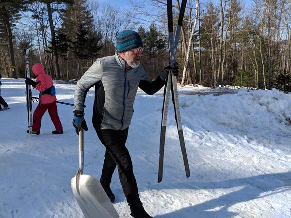 Windblown ski area owner Al Jenks spent a sunny Friday in late February skiing around his property, using a shovel to cover up persistent bare patches of ground with fresh snow.