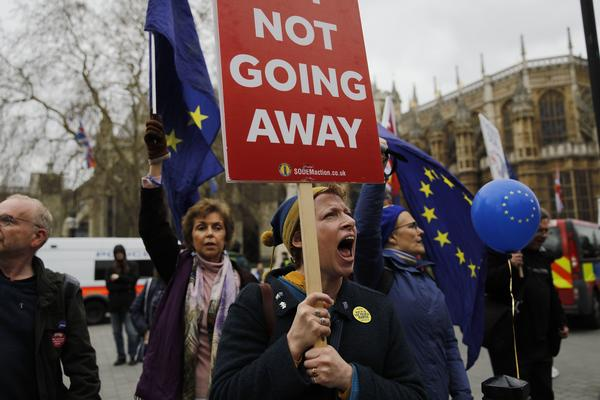 Demonstrators carry EU flags and shout slogans outside the Houses of Parliament in central London on March 21.