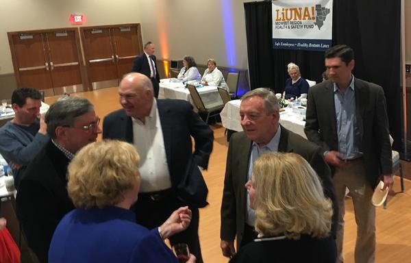 U.S. Sen. Dick Durbin speaks with guests at the Local 362 Laborers International Union dinner at Illinois State University's Bone Student Center on March 23.