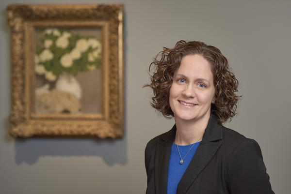 MacKenzie Mallon, provenance specialist at the Nelson-Atkins Museum of Art, with 'Still Life with Guelder Roses' in the background. The painting was siezed by Nazi forces in November 1943.