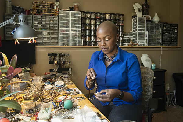 Jewelry designer Clarissa Knighten creates one-of-a-kind jewelry with artistic wire, gemstones and other found items.