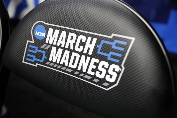 A chair with a logo is seen before a first round men's college basketball game between Minnesota and Louisville in the NCAA Tournament, Thursday, March 21, 2019, in Des Moines, Iowa.