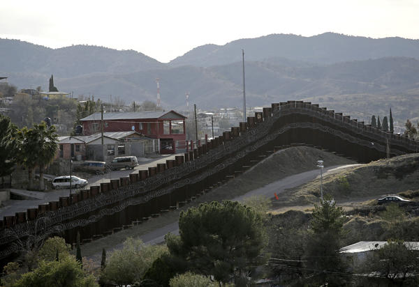 The president declared a national emergency in February to access federal money to build a wall similar to this razor-wire-covered border wall separating Nogalas, Mexico (left), and Nogales, Ariz. Congress did not approve the full amount he asked for last year to follow through on a key campaign pledge.