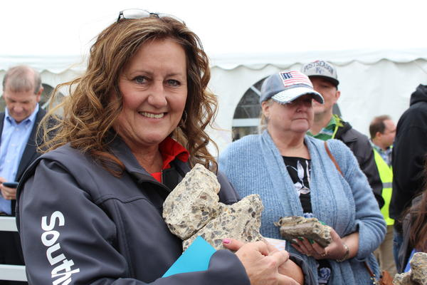 Cheryl Dugan, who has worked in customer service for Southwest Airlines for 18 years, took home pieces of Terminal A from the groundbreaking ceremony for a new single terminal.