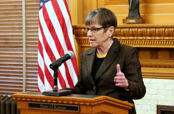 Gov. Laura Kelly issued her first veto Monday, rejecting a Republican tax relief package she calls irresponsible.