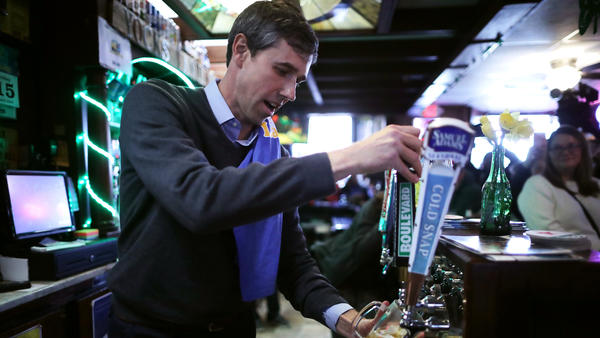 Democratic presidential candidate Beto O'Rourke pours a beer for a customer at Yock's Landing on March 15 in Mount Vernon, Iowa.