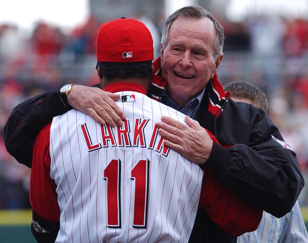 Former President George Bush hugs Reds shortstop Barry Larkin after throwing out the first pitch at Great American Ball Park prior to their opening game with the Pittsburgh Pirates in March 2003. The Reds were playing their first game in the new park.
