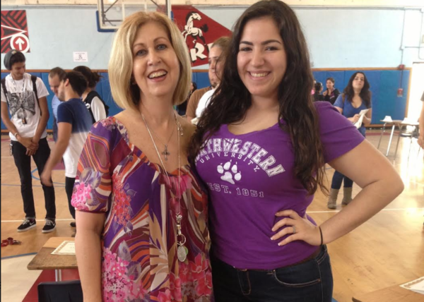 """College advisor Alina Grandal (left) stands next to then student Sabrina Rodriguez in 2013 for """"Academic Signing Day,"""" a program she organized every year for students to celebrate on May 1 when they had committed to a college or university."""