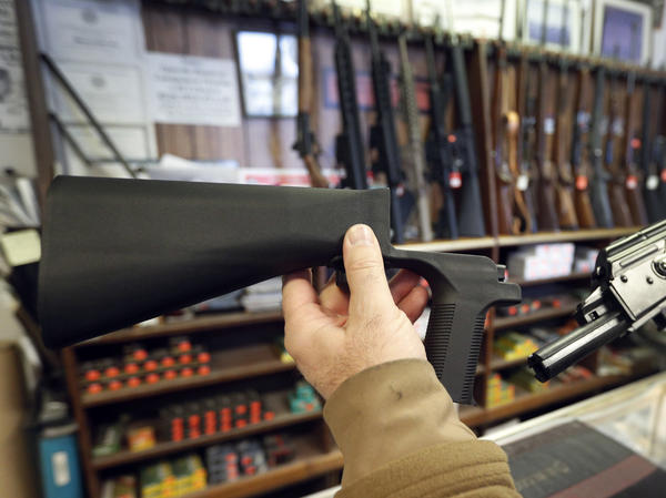 A bump stock, left, is a device that can be added to a gun to increase its firing speed. The devices were banned by the federal government his week.