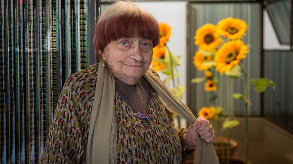 """French director and artist Agnès Varda has died. She's seen here posing next to her installation """"La serre du bonheur"""" at the Chaumont-sur-Loire castle on March 23."""