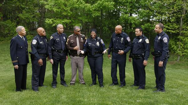 For three generations, members of the White family have served as police officers in the Indianapolis Police Department. Pictured are Clarence Sr. (from left), Clarence Jr., Rodney Sr., Keith, LeEtta, Rodney Jr., Christopher and Thomas White.