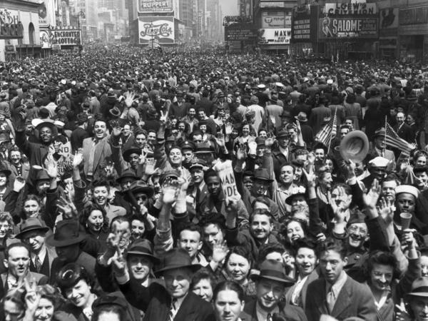 """An enormous New York crowd celebrates VE Day at the end of WWII. Aaron Copland was inspired to write his """"Fanfare for the Common Man"""" by a wartime speech rallying Americans against imperialism."""