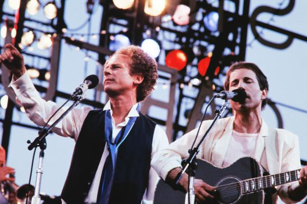 Art Garfunkel and Paul Simon perform in 1982 at Paris' Auteuil Hippodrome.