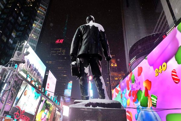 A statue of George M. Cohan, prolific Broadway composer and performer, stands in New York's Times Square.