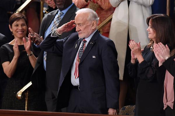 Former NASA astronaut Buzz Aldrin salutes as he is recognized by President Trump during the State of the Union.