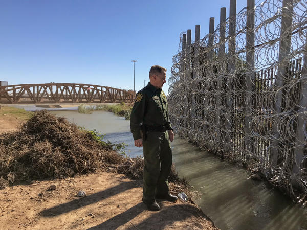 Anthony Porvaznik, chief patrol agent for the Border Patrol's Yuma sector, inspects a recently reinforced section of border fence in San Luis, Ariz. Porvaznik says a few weeks ago, 350 migrants, including children, burrowed under another spot of the border fence about 12 miles away.