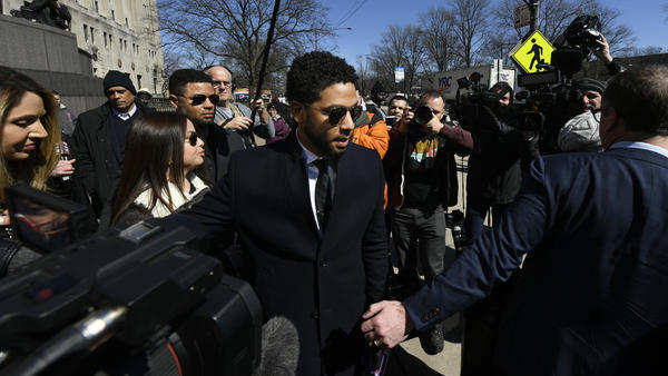 Jussie Smollett leaves a Chicago courthouse Tuesday, shortly after prosecutors dropped all charges against him. The move was met with anger from local authorities and confusion from plenty of onlookers.