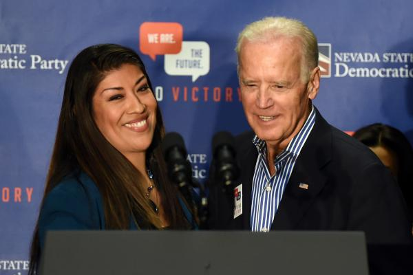 Then-Democratic candidate for lieutenant governor Lucy Flores and then-Vice President Joe Biden at a rally on Nov. 1, 2014 in Las Vegas. Flores accuses Biden of acting inappropriately during that visit.