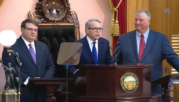 Senate President Larry Obhof (R-Medina, left) stands alongside Gov. Mike DeWine during DeWine's first State of the State speech in March. House Speaker Larry Householder (R-Glenford) is on DeWine's right.