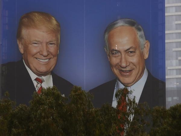 An election campaign billboard in Tel Aviv shows Israeli Prime Minister Benjamin Netanyahu with his close ally President Trump. Seeking re-election under a cloud of criminal investigations, analysts say Netanyahu has been channeling a Trump-style approach, with an angry campaign against perceived domestic enemies.