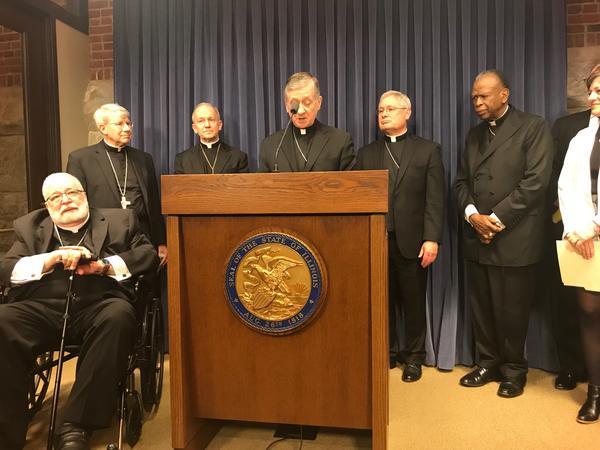 Cardinal Blase Cupich speaks at a press conference in Springfield.