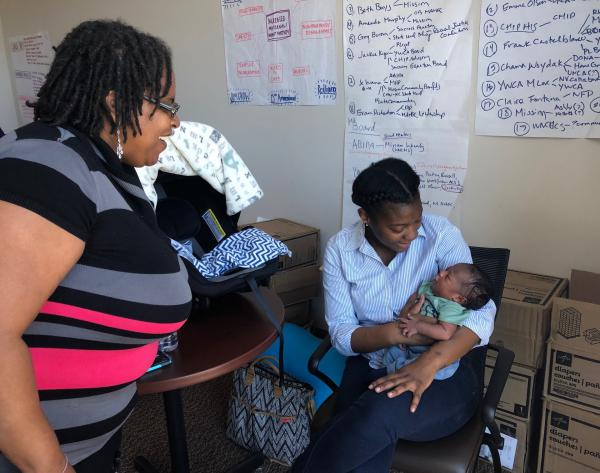 Sistas Caring 4 Sistas doula Wakina Norris (left) helped deliver Jared Baten's baby boy Jahir, just four weeks ago. Baten says Norris helped make sure her wishes for a natural birth were carried out in the delivery room.