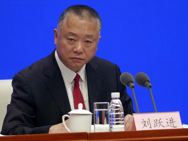 Liu Yuejin of China's National Narcotics Control Commission speaks at a Beijing press conference on Monday. He announced that all fentanyl-related drugs will become controlled substances, effective May 1.