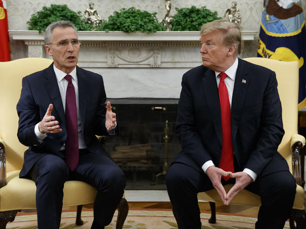 President Trump listens as NATO Secretary-General Jens Stoltenberg speaks during a meeting in the Oval Office of the White House on Tuesday.