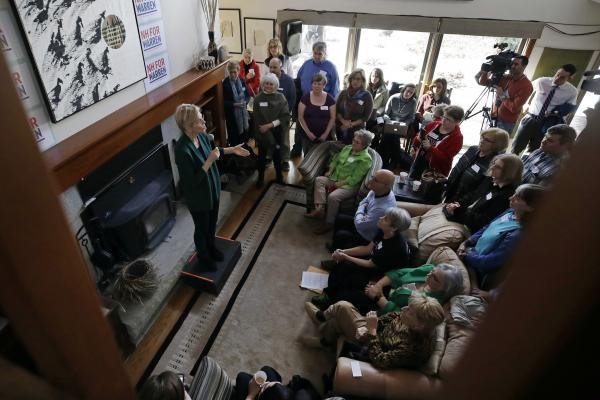 Democratic presidential candidate Sen. Elizabeth Warren, D-Mass., left, speaks at a campaign house party, last month in Salem, N.H. Warren has proposed abolishing the Electoral College.